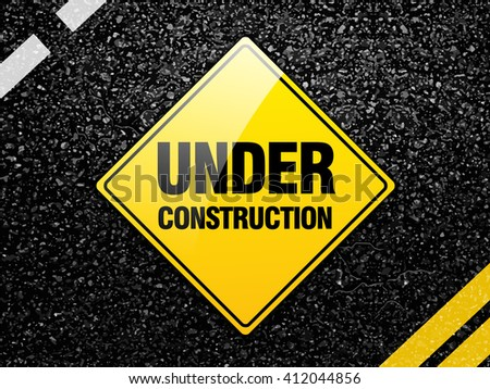 Under construction road sign on asphalt road surface vector