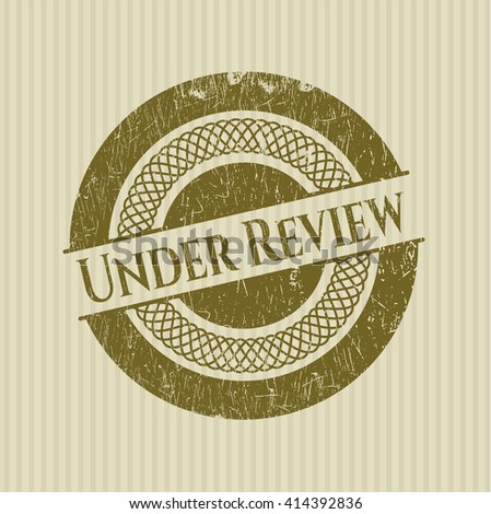 Under Review rubber seal with grunge texture - stock vector