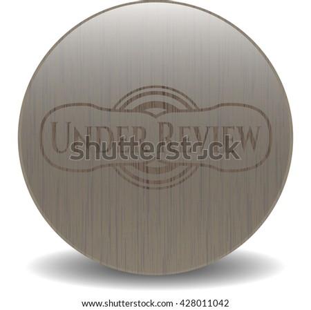 Under Review wood emblem. Vintage. - stock vector