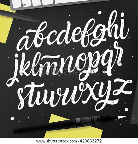 Vector artwork with hand written ABC set on black desk. Calligraphy collection. Brush Painted Characters. Creative White Table with Post-It note, Pen, Keyboard on background. Handwriting font.  - stock vector