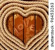 vector background with a heart of coiled rope on a wooden background - stock vector
