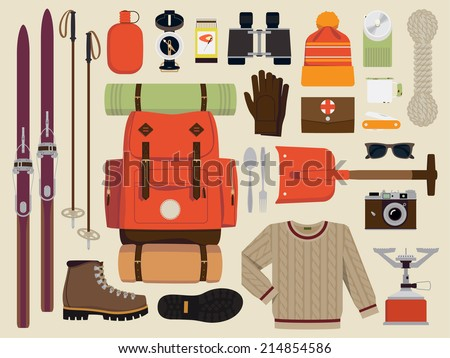 Vector flat illustration of winter hiking gear | Large set of snow backpack trip equipment | Winter exploring essentials featuring touring skis, hiking boots, shovel, binoculars, sweater and more - stock vector