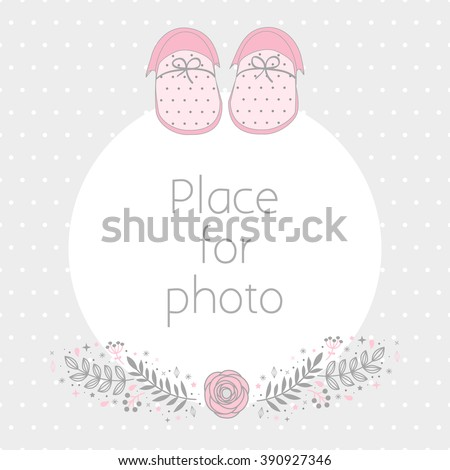 Vector frame for a photo with baby booties and floral design elements. Background polka dot pattern. Scrapbooking album page. - stock vector