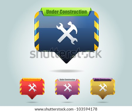Vector Glossy Under Construction Icon/Button and multicolored