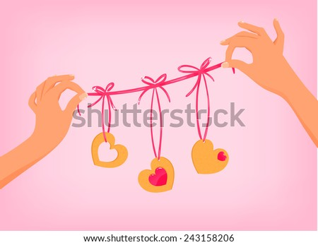 Vector hands holding cute Valentine's day garland with heart shaped cookies - stock vector