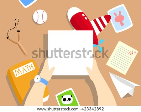 Vector Illustration: A cute, cartoon school boy's desk with toy plane, paper plane, test paper, math textbook, photos, baseball, slingshot on it. A blank paper / card is held by a child's hands.