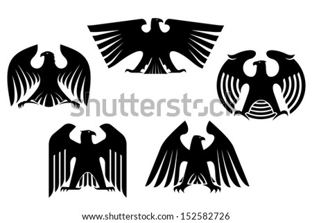 Vector illustration of silhouetted black stylized eagles with outspread wings and heads turned to the side, five different designs. Jpeg version also available in gallery - stock vector