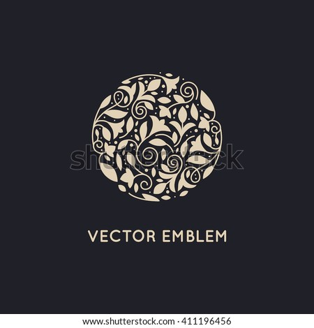 Vector logo design template and emblem made with leaves and flowers - luxury beauty spa concepts - natural badge for cosmetics