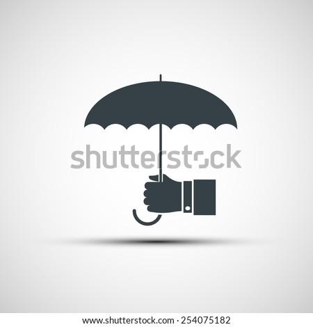 Vector logo of a human hand holding the umbrella - stock vector