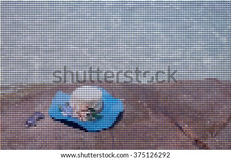 vector polygon  , beautiful blue hat and sunglasses on the stone with see view in sunny day