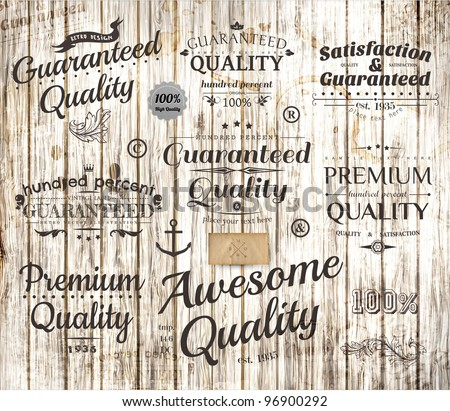 vector set of calligraphic design elements, page decoration, Premium Quality, Awesome and Satisfaction Guarantee Label collection, Vintage wood background - stock vector