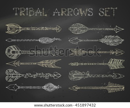 Vector set of chalk ethnic arrows on blackboard background. Hand-drawn tribal design elements. Boho and hippie style.