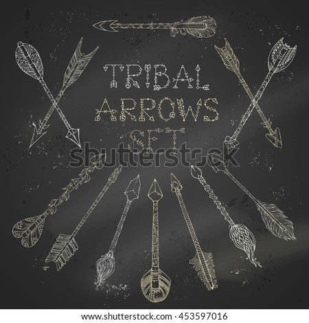 Vector set of chalk tribal arrows on blackboard background. Ethnic arrows sketch illustration. Boho and hippie hand-drawn style. - stock vector