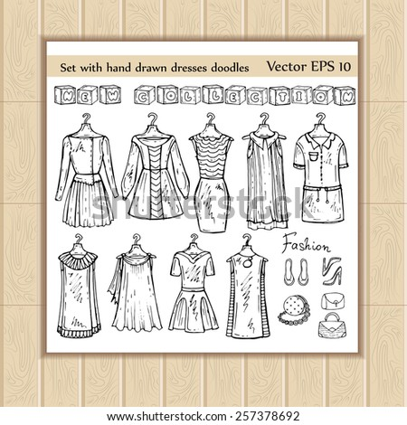 Vector set of fashionable and hand drawn dresses doodles. Sketches for use in design - stock vector