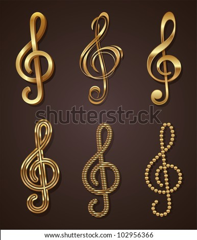 Vector set of golden decorative treble clef - stock vector