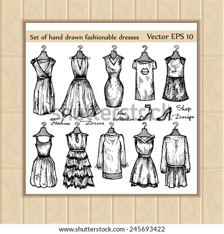 Vector set of hand drawn fashionable dresses. Sketches for use in design - stock vector