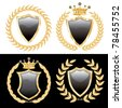 vector set of the black shields with golden laurel - stock vector