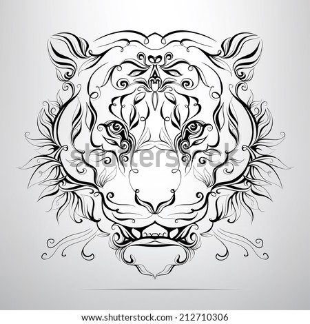 Vector tiger head in the ornament - stock vector