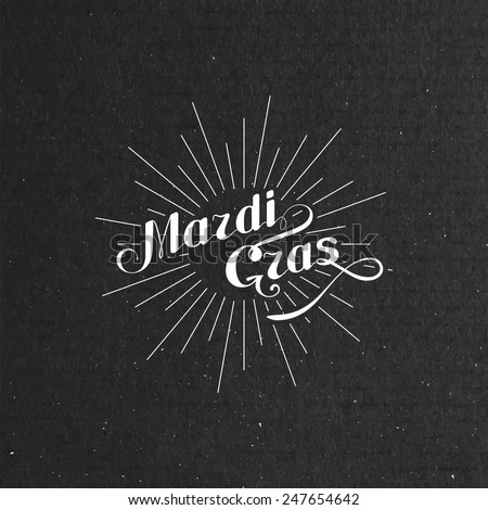 Vector typographical illustration of ornate Mardi Gras label on the black cardboard texture  - stock vector