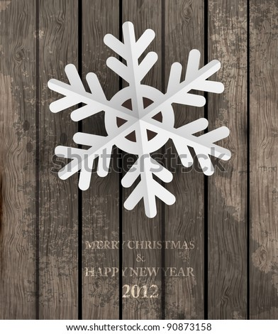 Vector white paper christmas snowflake on a wood background - stock vector