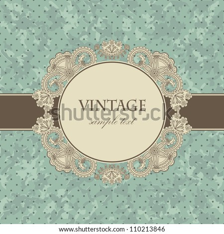 Vintage card with a floral frame on a blue grunge background with polka dots