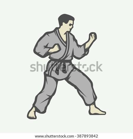 Vintage karate or martial arts logo, emblem, badge, label and design elements. Vector illustration - stock vector