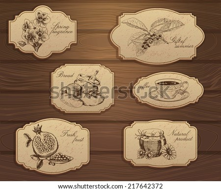 Vintage labels set. Hand drawn illustrations. Wooden background with sketches - stock vector