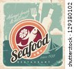 Vintage poster for seafood restaurant. Retro paper background with fish, wine bottle and food. Old fashioned graphic design. - stock vector