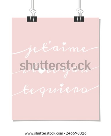 """Vintage style poster for Valentine's Day with the phrase """"I Love You"""" in 3 languages - French, English and Spanish, on a pink background. Poster design mock-up with paper clips, isolated on white. - stock vector"""