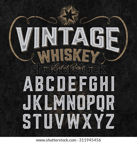 Vintage whiskey label font with sample design. Ideal for any design in vintage style. Vector. - stock vector