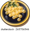 white caviar on a plate with fresh greens - stock photo