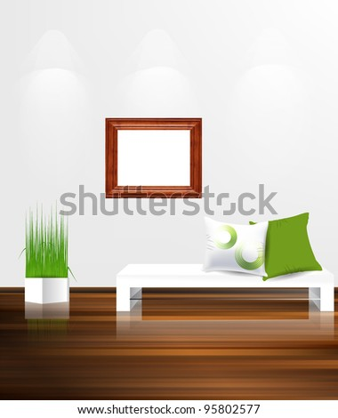 White couch with pillows against white wall with empty wooden frame. - stock vector