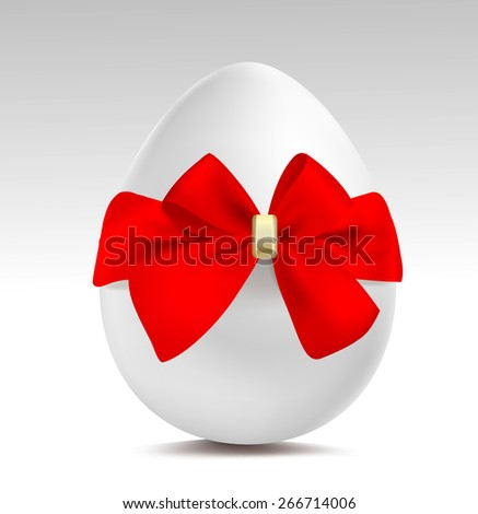 White egg with red bow