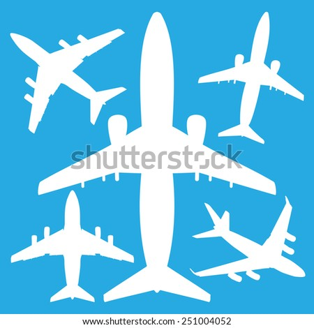 white jet airliners in the air isolated on blue background - stock vector