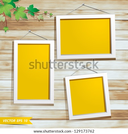 White photo frame on wood background, With green leaves decoration design - stock vector