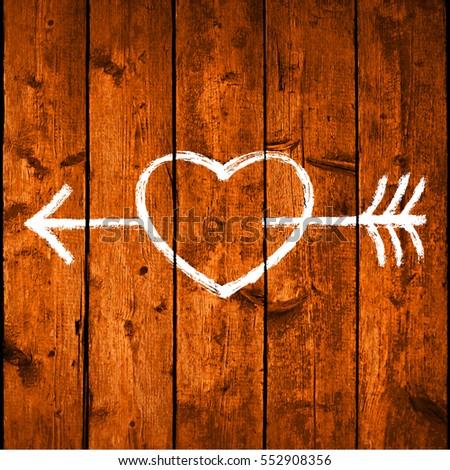 White shape heart pierced by an arrow on brown realistic texture wood planks with natural structure. Vector illustration design elements save in 10 eps