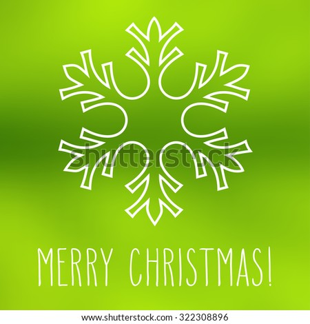 White snowflake over square abstract smooth blur background with hand written Christmas greetings.