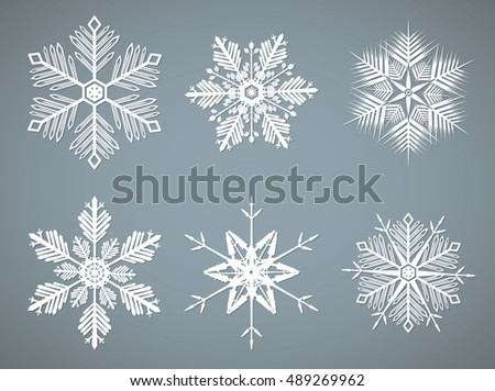 White vector snowflakes shapes on gray background