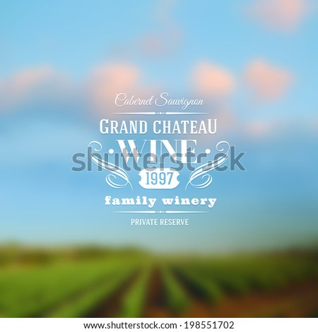 Wine label type design against a vineyards landscape defocused background - stock vector