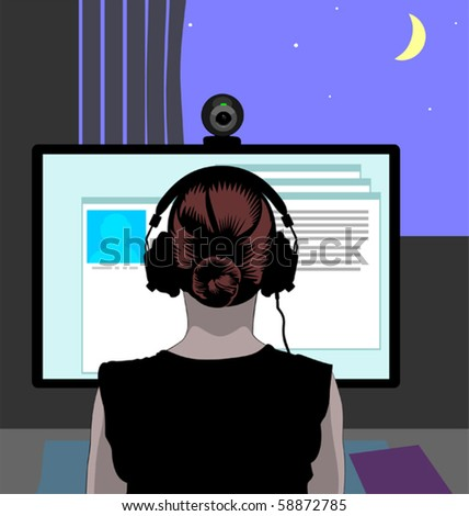 Woman in headphones in front of her computer communicating via web camera, the blue night sky with a crescent seen in the window.