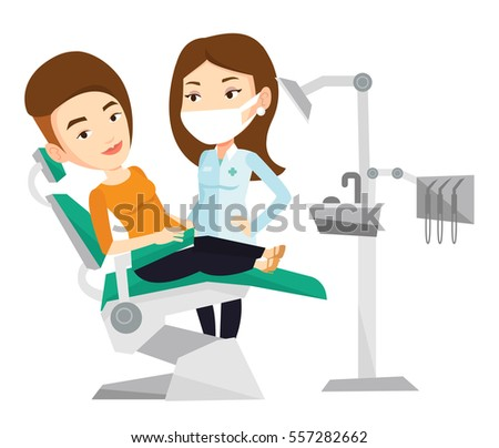 Woman Sitting In Dental Chair While Dentist Standing Nearby Doctor And Patient The