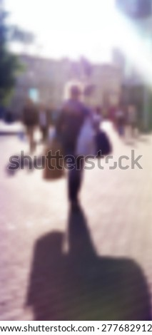Woman walking on the street. Blurred Image Background.