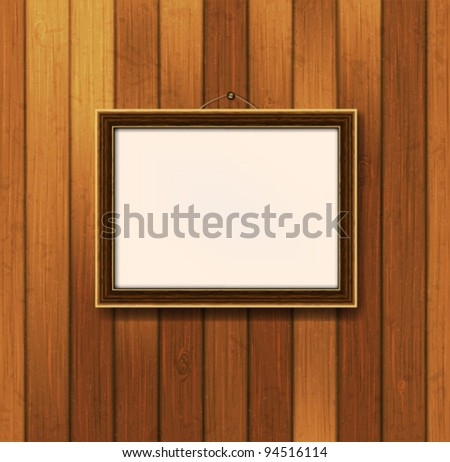 wooden frame for a photo on the background wooden boards