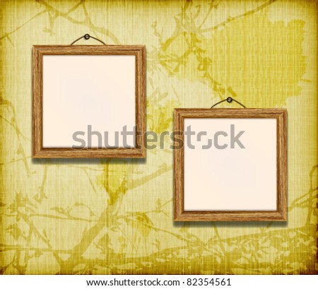 Wooden frame for photo on the grunge floral fabric background - stock vector