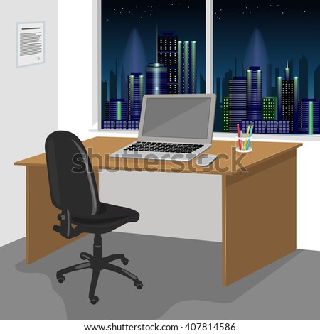 work desk interior with a laptop computer and window with night city scenery