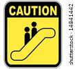 yellow caution sign warning people to be careful on the escalator - stock photo