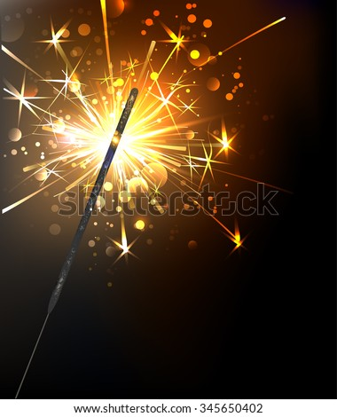 yellow, sparkling sparkler on a black background.