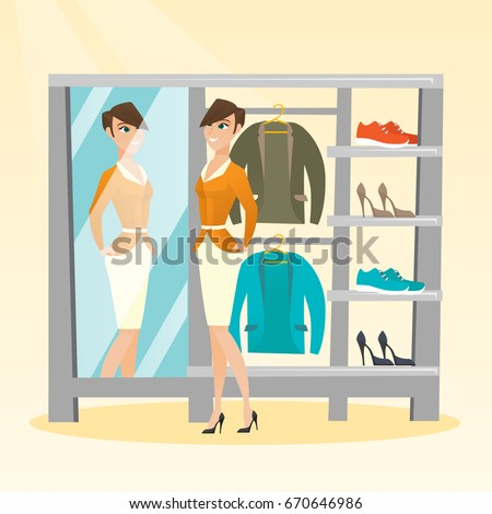 Young Caucasian Woman Looking In The Mirror Dressing Room Trying On Jacket
