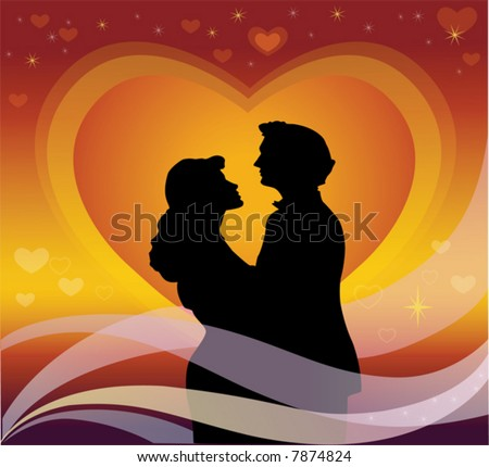 Young couple in silhouette against sunset heart