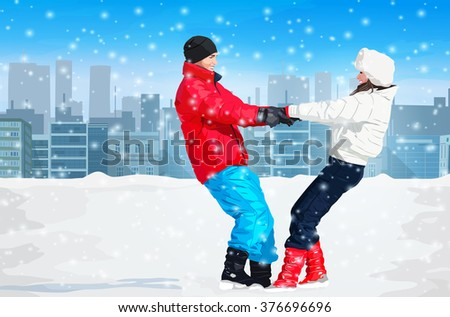 Young happy couple outdoors winter fun on city background
